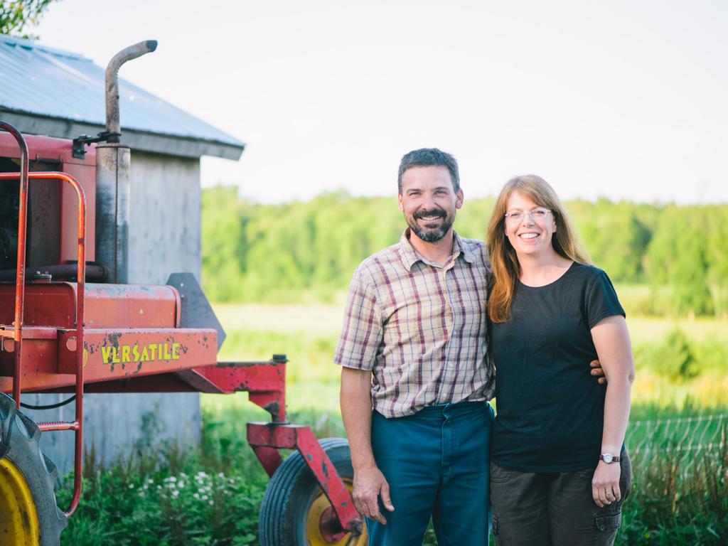Farmer couple in yard